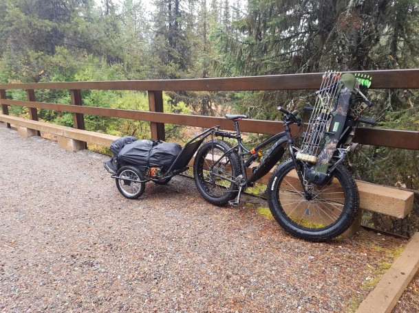 Norco Bigfoot hunting setup with trailer and bows